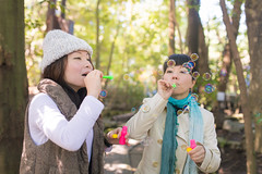 Happy sisters blowing bubbles in forest (Apricot Cafe) Tags: img29178 3039years asia asianandindianethnicities japan japaneseethnicity kyotojapan sigma35mmf14dghsmart blowing candid casualclothing charming cheerful day enjoyment forest freedom friendship happiness horizontal lifestyles morning nature onlywomen outdoors photography relaxation sister smiling soapsud springtime togetherness tourism tourist traveldestinations twopeople waistup weekendactivities women yoshidayama youngadult kyōtoshi kyōtofu jp