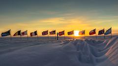 The Start of the South Pole Winter (redfurwolf) Tags: southpole ceremonialpole flag sun sunset outdoor nature landscape snow ice clouds sky pole marker redfurwolf sonyalpha a99ii sony sal2470za