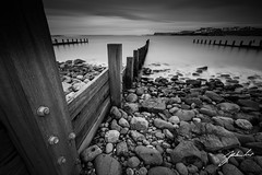 Groynes at Portballintrae. Northern Ireland. (jtat_88) Tags: 09neutraldensityhardgrad 2017 amateur atlanticocean bw bay beach blackandwhite bold breakwater causewaycoast coast coastaldefence contrast countyantrim cove digital engineering erosion fairhead filters fullframe grain groyne guardian hold ilce7 inlet ireland landscape lee leebigstopper leefilters leelandscapepolariser longexposure manmade march mirrorless moody motion nature neutraldensity northernireland northcoast old perspective photography portballintrae protection reach rocks rustic scenic sea seascape seaside seawalls seaweed sel1635z sentinel sentry shingle shore shoreline sony sonya7 sony1635mmf4variotessartfezaoss spring swell weather wet wideangle wood wooden zeiss
