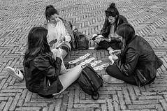 """ A day trip to Siena ... a missed opportunity. "" (pigianca) Tags: italy siena piazzadelcampo ilcampo girls play monochrome blackwhite streetphoto urbanphoto leicaq candidportrait"
