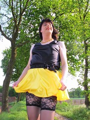 Holding my skirt (Paula Satijn) Tags: sexy hot girl skirt miniskirt satin silk silky shiny yellow gurl tgirl black outside tree spring smile fun joy happy legs stockings lace stockingtops lacy sensual