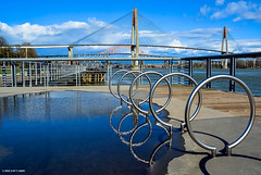 """""""Reflections"""" at Westminster Pier Park - City of New Westminster, BC (SonjaPetersonPh♡tography) Tags: newwestminster britishcolumbia canada waterfront fraserriver boardwalk pierpark waterfrontesplanade park river riverfront newwestminsterriverfront concession grass trees spraypark benches picnictables playground viewpoints gardens volleyballcourts landscape scenic patullobridge trainbridge skytrain skytrainbridge nikond5200 nikon afsdxnikkor18300mmf3556gedvr waterfrontpark waterfrontpierpark westminsterpierpark bridges waterreflections reflections rings blueskies"""