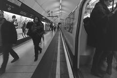 tube (Chris_J) Tags: street city uk urban white black london public canon underground photography eos blackwhite metro transport tube sigma commute publictransport 400d