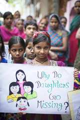 """A young girl holding a banner that says 'Why do daughters go missing?"""" at a Beti Utsav community celebration in Bhalswa, New Delhi. (ActionAid UK) Tags: new pink girls baby india female march women babies singing dancing delhi protest selection parade celebration demonstration human abortion rights marching drumming utsav gender newdelhi placards selective actionaid beti infanticide bhalswa foeticide vawg"""