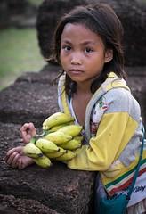 Banana Girl (Trent's Pics) Tags: girl temple cambodia banana monastery siemreap roluosgroup bananagirl