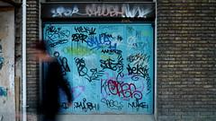 Montevideo 2013 (Gabri Le Cabri) Tags: door man silhouette walking graffiti dusk montevideo nuke pher caes 2per calush