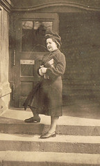 Ready to go out (TrueVintage) Tags: door woman stairs oldphoto frau past foundphoto tür stufen vergangenheit vintagephoto haustür vintagewoman