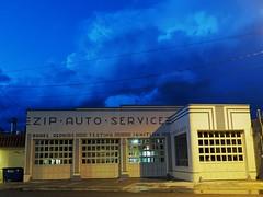 """Zip"" - Missoula, Montana (TravelsWithDan) Tags: city nightphotography urban montana cityscape missoula artdeco zip thunderhead streetlevel autogarage"