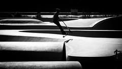 Riding... (elgunto) Tags: scooter ride skate park barcelona poblenou street people blackwhite bw streetphoto nikonj1 30110mm highcontrast