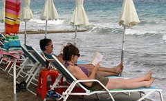 book readers on the beach IMG_1891 (mygreecetravelblog) Tags: greece peloponnese tolo tolon toloresort tolobeachresort beachresort greekbeachresort beach tolobeach tolonbeach greekbeach coast shore seaside outdoor landscape books reading loungers sunbeds