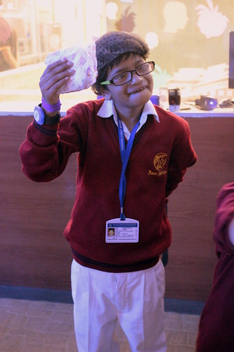 KidZania Tour for Kids with disabilities:The little chef proudly showing the burger he made.