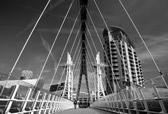 Lowry Bridge - B&W (PangolinOne) Tags: architecture bw blackwhite blackandwhite bridge canonef24105mmf4lisusm canoneos6d cityscape ef24105mmf4lisusm england lowrybridge lowrymillenniumbridge manchester millenniumbridge places salford salfordquays salfordquaysmillenniumfootbridge salfordquaysliftbridge uk urban unitedkingdom gb