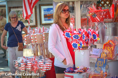 Ms Red White and Blue © Catherine Crawford 2017 (Zimbrit) Tags: red whiteandbluewomanpeoplemontrosefarmers market california usa flags usc ucla