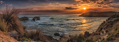 Sunset hues (Rob Reaburn Photography) Tags: bridgewaterbay blairegowrie keyholerock sunset colourful colorful ocean beach bay seascape panorama morningtonpeninsula victoria australia reflection sunrays sunstar crepuscularrays twilight tide waves rocks golden light