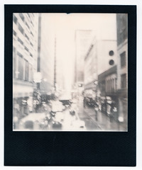 Impossible-102-BWSX70-ChicagoWabash (k.james) Tags: kenthenderson kjameshenderson impossible impossiblefilm instantfilm polaroid sx70 bw blackframe chicago theloop chicagoloop thel downtown city