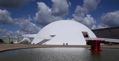 Under the dome . . . (ericrstoner) Tags: anvil bigorna dome cúpula nationalmuseum museu nacional oscarniemeyer niemeyer clouds nuvens bike bicycle bicicleta brasília distritofederal