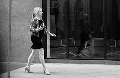 Plan In Action (burnt dirt) Tags: houston texas downtown city town mainstreet street sidewalk streetphotography fujifilm xt1 bw blackandwhite girl woman people person blonde ponytail heels stilettos walking phone cellphone purse bag blackdress littleblackdress window glass
