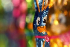 Easter bunnies. (Dikke Biggie.) Tags: easter pasen happyeaster vrolijkpasen easterbunnies paaskonijntjes paaskonijnen bunny bunnies konijn konijnen colors colours colorful kleuren kleurrijk chocolate chocolade candy snoep dof depthoffield scherptediepte bokeh canon canoneos450d 100mm f28 canonnl dgawc macro closeup detail