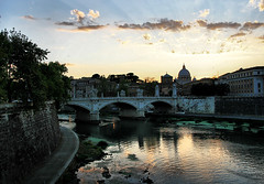 Sunset over the Vatican (` Toshio ') Tags: toshio rome italy vatican stpetersbasilica roman italian sunset tiberriver ponteumberto river reflection clouds europe european europeanunion bridge city basilica church catholic