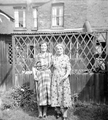 Two women in the garden (vintage ladies) Tags: portrait people photograph photo vintage blackandwhite 50s lady female woman 50slady 50swoman ladies women 50sladies 50swomen 50sstyle garden dress mature belt cat washing stylish necklace pretty lovely eoshe