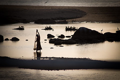 fisherman (paul.wienerroither) Tags: ocean travel light reflection water silhouette canon photography lights fisherman srilanka
