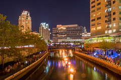 Waterfire, Starbridge from downriver (jennsunique) Tags: city light color building night mall river fire lights star boat movement downtown nightscape basin providence rhodeisland attraction waterfire 2014 starbridge