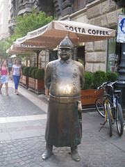 city guard (VERUSHKA4) Tags: street city girls summer people sculpture man building bike canon cafe funny europe hungary cityscape view metallic object budapest july rue vue verdure