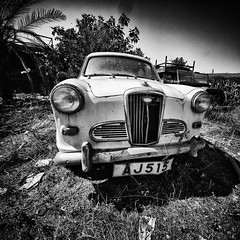 old lakatamia#3- (big andrei) Tags: leica bw abandoned car voigtlander cyprus 12mm monochrom f56 ultra wolseley nicosia wideheliar lakatamia