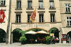 cafs of Bern: caf du commerce (Michela Pedranti) Tags: street plants building film analog 35mm vintage photography switzerland streetphotography flags fujifilm bern analogue reportage caf berna fujicolor filmphotography
