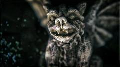 Halloween Hound (hbmike2000) Tags: macro halloween glass closeup glitter dark wings lowlight nikon bokeh hound chain gargoyle candlelight d200 fangs snowglobe hoya odc closeuplens hbmike2000 yourphotographystyle