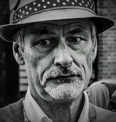 Portrait (pootlepod) Tags: street portrait blackandwhite man male monochrome hat closeup photography couple looking lewes stphotographia