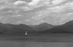 Loch Lomond Delta 400 Pyro HD Scotland (Man with Red Eyes) Tags: analog scotland blackwhite rangefinder pyro ilford lochlomond underexposed leicam2 delta400 homedeveloped semistand presoak 11100 silverhalide sunnysixteen pyrocathd milarrochybay elmaritm90mm 18mins