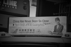 Cab Ad (rcezila) Tags: china blackandwhite white newyork black america airplane cab aircraft ad advertisement airline