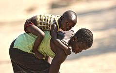 Hang on tight (sarang2000) Tags: baby bay holding mother breeze nyasa lakemalawi senga