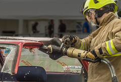Firemen demonstrating a hydraulic rescue cutter on a car roof (Anguskirk) Tags: uk england farming eu demonstration vehicle berkshire agricultural newburyshow showground fireandrescueservice royalcountyofberkshireshow topazremask hydraulicrescuecutter