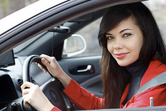 Pretty brunette driving a car (limoadelaide) Tags: auto road new red peopl