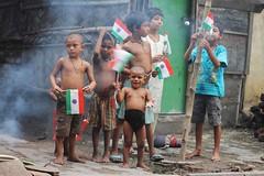 Independence day (sanghamitra_srkr) Tags: india smile children freedom little flag smoke enjoy indeoendence