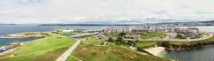 Corua (dfvergara) Tags: espaa verde azul mar edificios agua torre ciudad playa galicia cielo nubes prado hercules pradera lacorua torredehercules