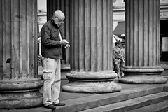 Contact (Leanne Boulton) Tags: life lighting street old city uk light shadow portrait people urban blackandwhite bw sunlight white man black detail male texture monochrome face lines mobile canon army photography 50mm mono scotland blackwhite aperture focus technology shadows phone natural humanity outdoor expression glasgow candid telephone columns streetphotography angles cellphone scene communication human age shade 7d soldiers contact aged bandw depth tone facial diffuse candidstreetphotography