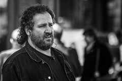 Plugged in (Frank Fullard) Tags: frankfullard fullard candid street portrair madrid spain espana monochrome blackandwhite earplug listen music ipod beard portrait hair curls