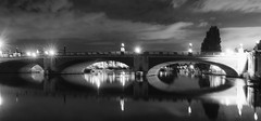 at night the urban stars shine so bright - HMM! (lunaryuna) Tags: england hamptoncourt london royalresidence hamptoncourtbridge architecture bridge night nightphotography nocturnalphotography riverthames reflections nightlights seeingdouble blackwhite bw monochrome lunaryuna urbanconstructs le longexposure sky clouds
