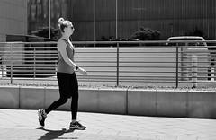 After Work Walk (burnt dirt) Tags: houston texas downtown city town mainstreet street sidewalk streetphotography xt1 fujifilm bw blackandwhite girl woman people person phone cellphone bag purse athlete walk run jog running walking jogging tights leggings yogapants ponytail headphones glasses sunglasses