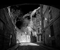 "out from under Union Street, Correction Wynd in B&W, iPhone, Aberdeenshire, Scotland (grumpybaldprof) Tags: ""correctionwynd"" ""thehouseofcorrection"" 1637 ""provostjaffray 1711 ""cobbledstreet""cobbles ""stnicholaskirk"" graveyard granitewall ""oldstreet"" road ""stnicholaskirkyard"" vagrants delinquents punishment car lights moody mood sky clouds contrast blacks whites ""darksky"" ""bwhdr"" detail stones monochrome fineart blackandwhite blackwhite bw aberdeen ""aberdeencity"" ""granitecity"" grampian scotland uk ""beautifulcity"" ""northeastscotland"" aberdeenshire ""iphone6backcamera415mmf22"" ""iphone6"" blacksky noireetblanc"