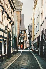 all the alleys (lina zelonka) Tags: einbeck niedersachsen lowersaxony linazelonka germany deutschland europe europa vertical alley fachwerk timber timberframe architecture german town houses nikond7100 18105mm