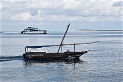 The Old and the New of Zanzibar (The Spirit of the World) Tags: zanzibar island ocean seascape sea water indianocean dhow excursionboat clouds tanzania eastafrica africa paradise tropical recreation