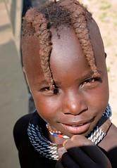 Himba child shows off their traditional forward hair braides. (One more shot Rog) Tags: himba nature namibia tribal rtibes tribe safari himbavillage himbtribe womanhimba peoplemakeupmake upbradesremotetraditionaltraditionone more shot rogroger sargent wildlife photographyafricanafrica safariova ovahimba damara herero