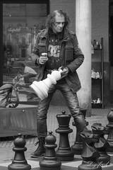 Let's play a game. (Digifred.) Tags: digifred 2017 amsterdam nederland netherlands holland iamsterdam straat street city grachten streetphotography pentaxk3 blackwhite blackandwhite monochrome people portret portrait candid schaken chess spel game euweplein