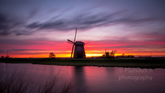 Schermerhorn mills during sunset (Dennis-Dieleman) Tags: sunset mill mills windmill windmills water long exposure beautiful colors dutch holland netherlands molen molens nederland alkmaar schermerhorn clouds skyporn sky cloudscape cloudporn dike trees silhouette evening moving wind