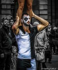 Balancing Act (FotoFling Scotland) Tags: festival royalmile balancingact facepaint highstreet male muscles street streetperformer streettheatre fotoflingscotland