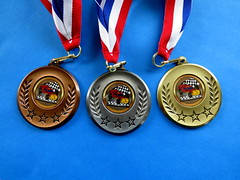 Awards (diffuse) Tags: medal lanyard bronze silver gold pinewood car flag checkered red white blue star laurel